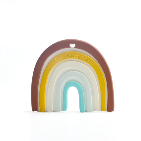 A gender-neutral silicone rainbow teething toy with neutral brown, mustard, cream, and blue stripes