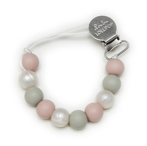 A silicone pacifier clip with rose, grey, and pearl-coloured silicone beads. Designed in Canada.