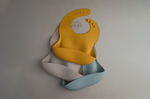 The yellow silicone catch all bib in a bundle with our vintage indigo and mushroom silicone bibs as a baby shower gift