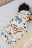 Baby sleeping in their safari print sleep sack