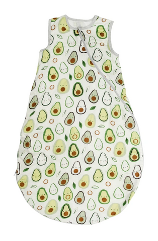 A white muslin sleep sack with happy green avocados on it
