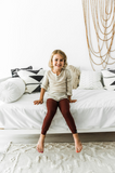 Young girl wearing handmade lounge pants in wine red