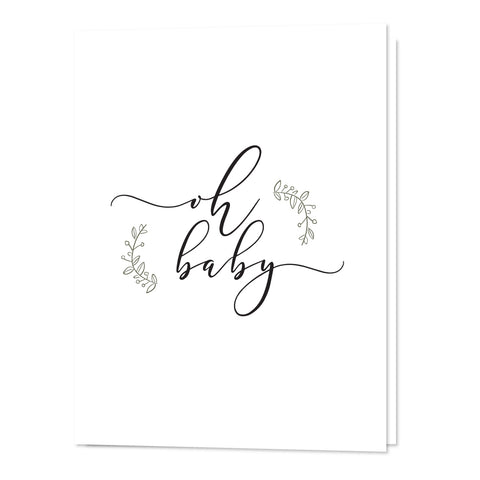 A gender neutral baby shower card that was ethically handmade in Canada. It has loopy cursive saying Oh Baby and two light leaf branches