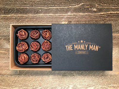 Bacon roses, sliding out of sleeve, on wood background