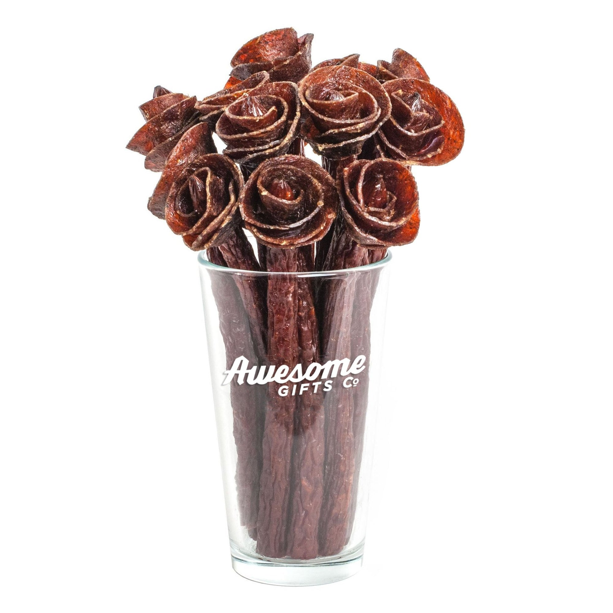 Awesome beef jerky roses in pint glass on white background