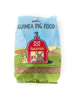 Guinea pig food bag. Picture of cartoon guinea pig and rabbit in a red barn on front of bag