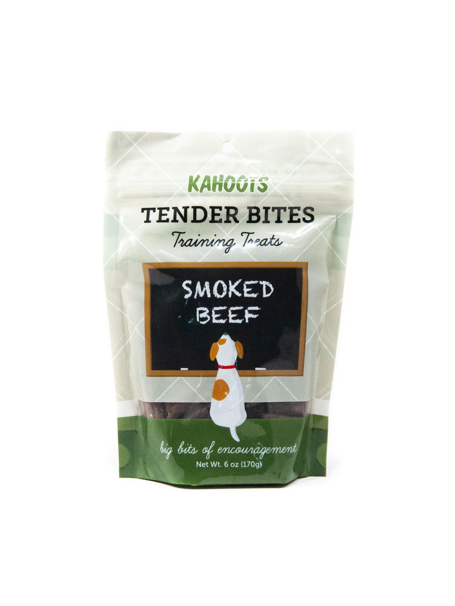 Beef dog treats in a bag. Picture of a cartoon dog sitting in front of a chalk board over a green background