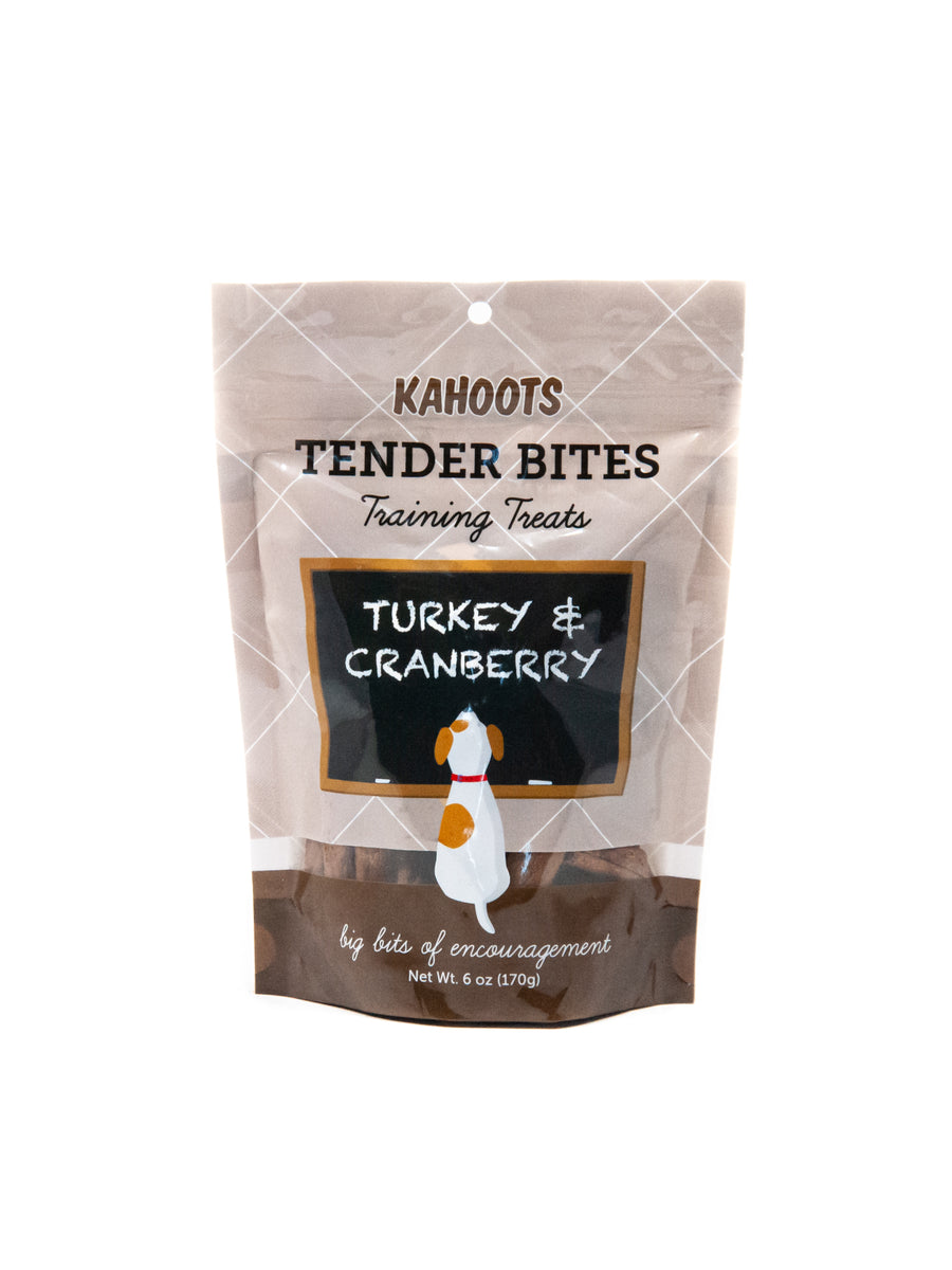 Turkey and cranberry dog treats in a bag. Picture of a cartoon dog sitting in front of a chalk board over a brown background