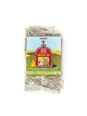 Bundle of Timothy hay in a bag. Cartoon of a rabbit and a guinea pig inside a red barn on label. 28oz