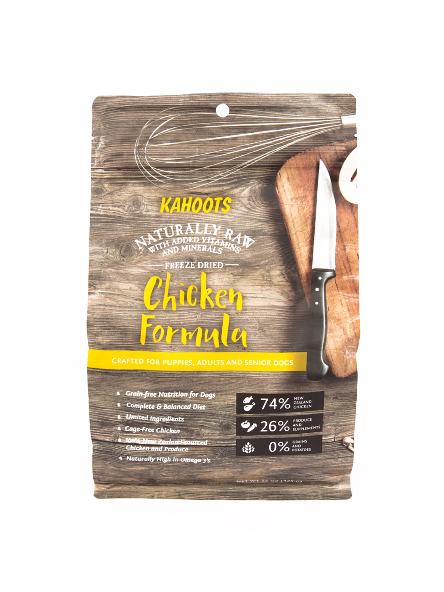 Freeze-dried chicken dog food formula. Picture of cutting board and cooking tools on bag
