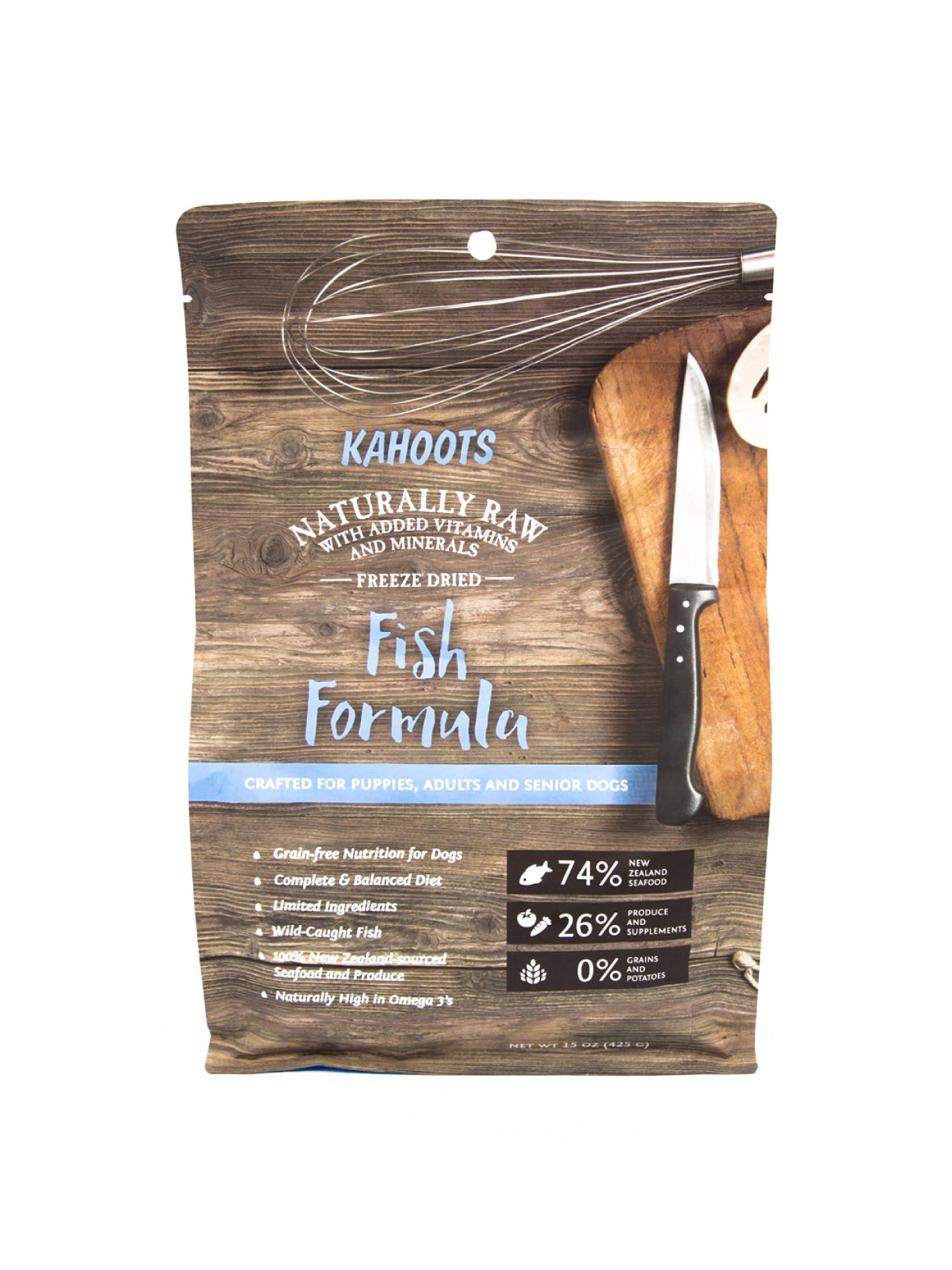 Freeze-dried fish dog food formula. Picture of cutting board and cooking tools on bag