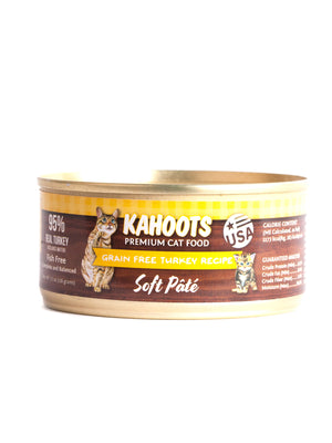 Grain-free turkey wet cat food. Picture of adult cat and chicken over yellow checked background on can