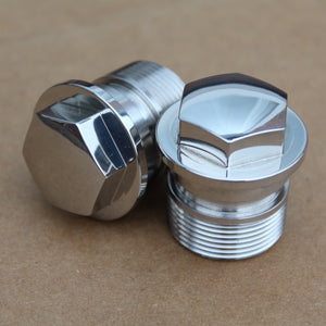 a pair of fork tube nuts honda in polished stainless steel
