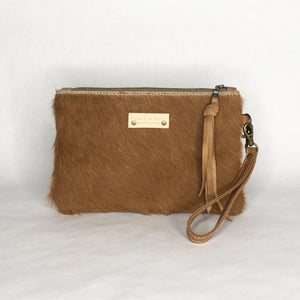 Boho cowhide clutch by Marge & Rudy handmade