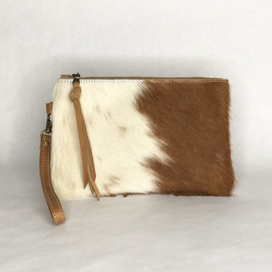Handmade brown and white cowhide wristlet clutch by Marge and Rudy