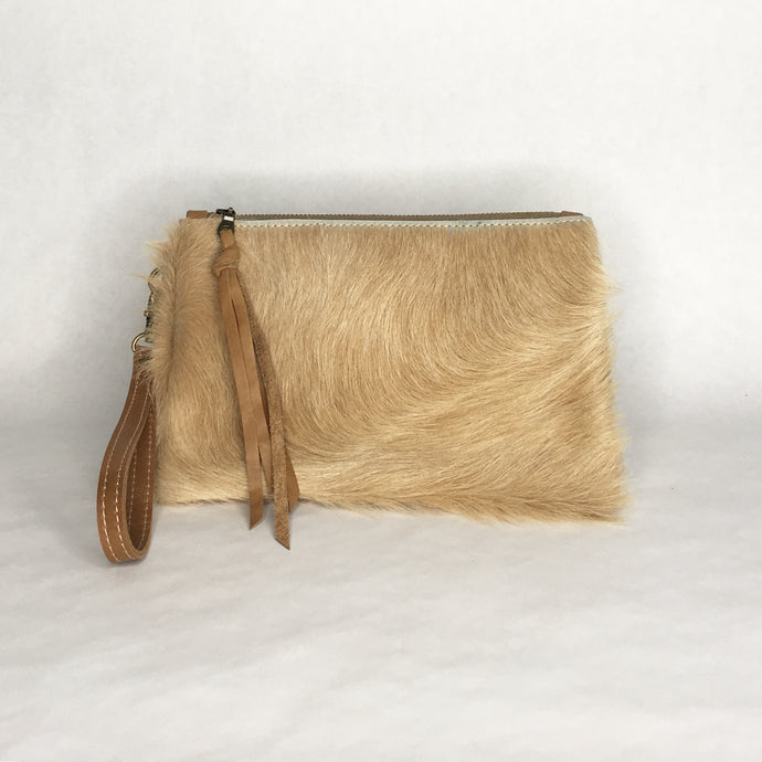 Handmade bohemian cowhide wristlet clutch by Marge and Rudy