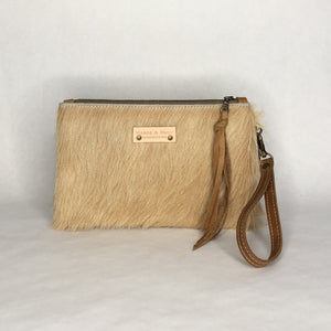 Handmade cowhide wristlet clutch by Marge and Rudy