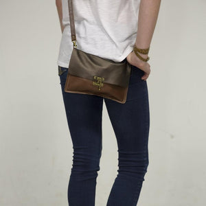 Girl wearing a RRR crossbody bag by Marge & Rudy with jeans and boots