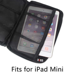 black travel organizer with mesh pocket holding an ipad mini. plentiful travel travel products.