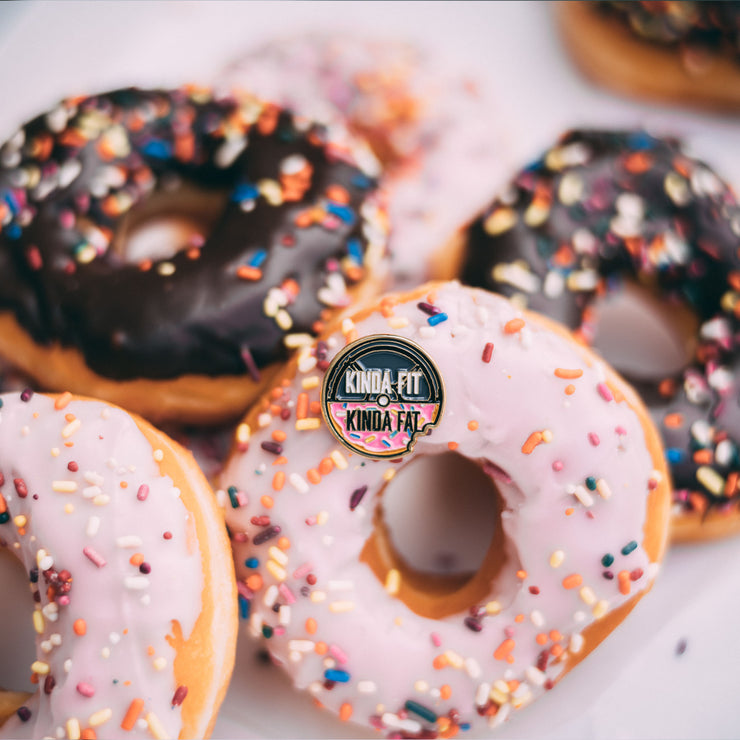 Kinda Fit Kinda Fat Donut Logo Pin amongst donuts