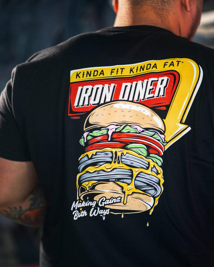 Millennial man wearing Iron Diner T-shirt in black.