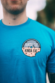 Kinda Fit Kinda Fat Premium Unisex Turquoise T-shirt. Original KFKF Cookie Logo on front left chest. Kinda Fit Kinda Fat Bar Logo Back.