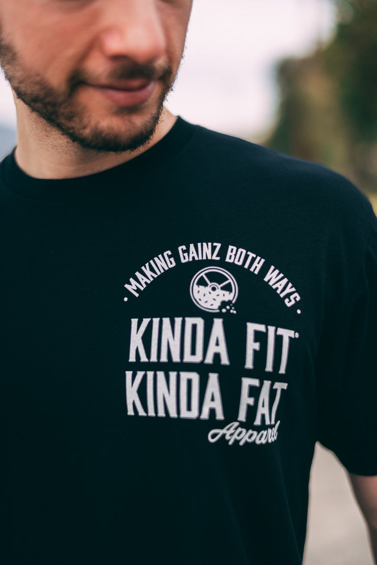 Millennial male wearing Kinda Fit Kinda Fat Premium Unisex Black T-shirt.