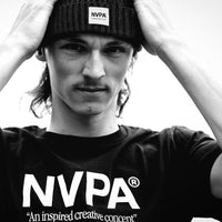 Model wears NVPA® t-shirt and patch beanie