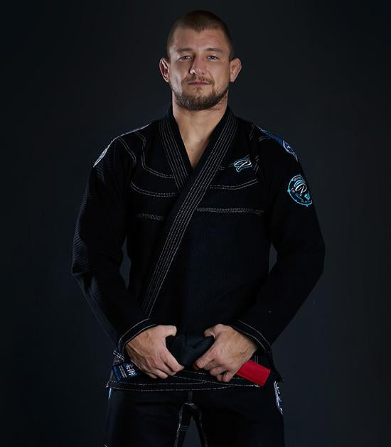 Front view of a Ground Game Player BJJ Gi Black