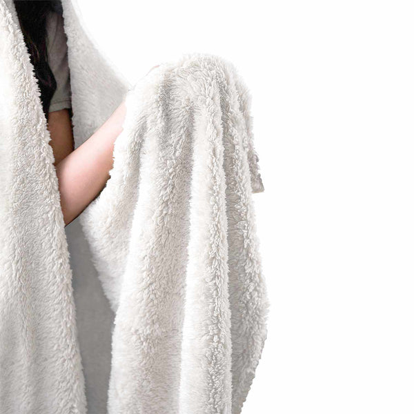 a person showing inside of hooded blanket