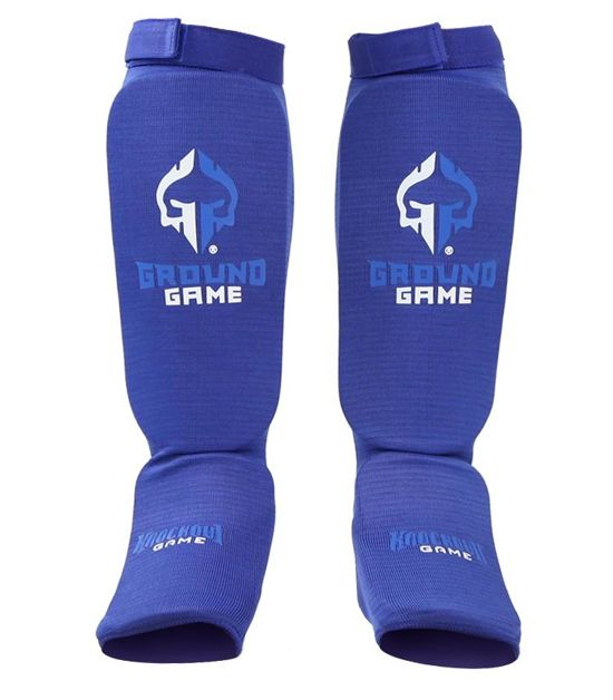 Front view of a Ground Game Knockout Game Elastic Shin Guards Blue