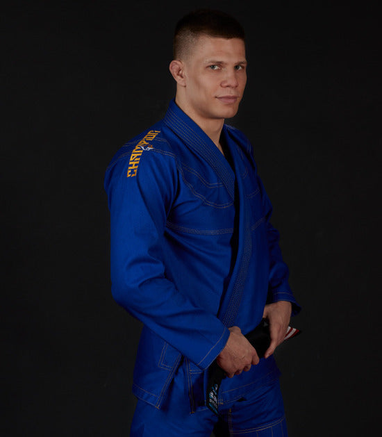 Side view of a Ground Game Champion 2.0 BJJ Gi Blue