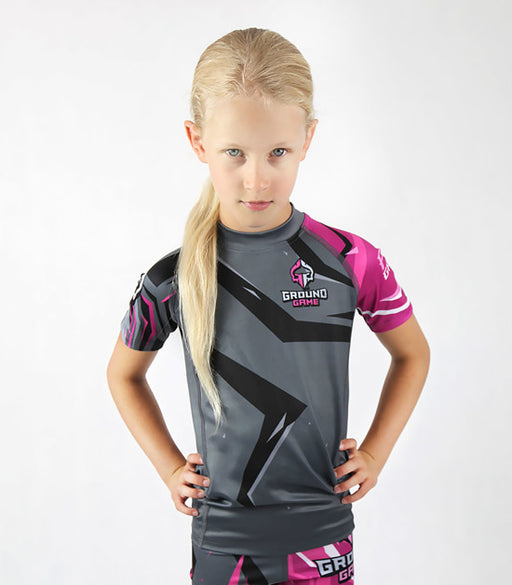 Front view of a Ground Game Clash Kids Rashguard