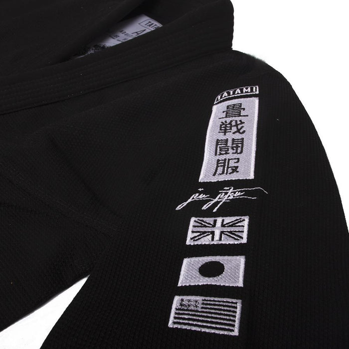 Tatami Signature BJJ Gi black front closeup sleeve left patches