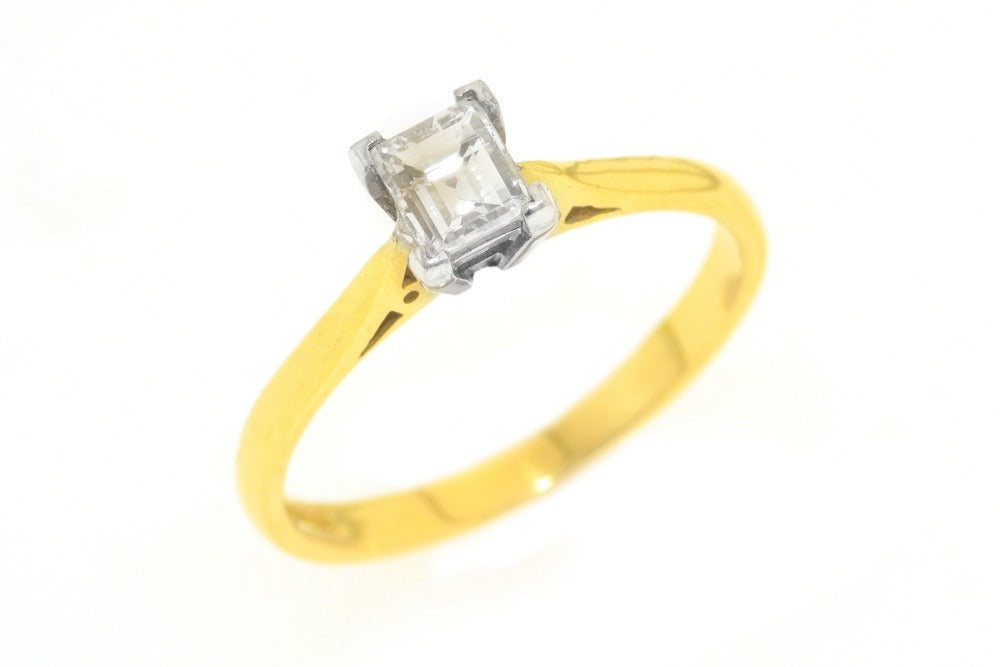 18ct yellow and white gold ring with .50 carat diamond.