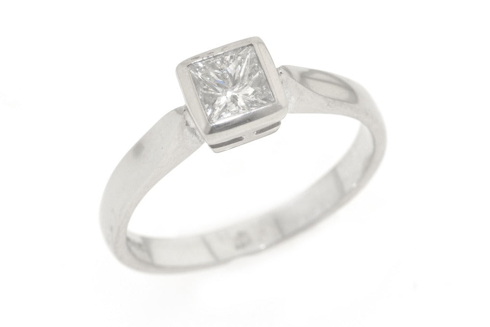 18ct white gold ring with 50 point princess cut diamond.