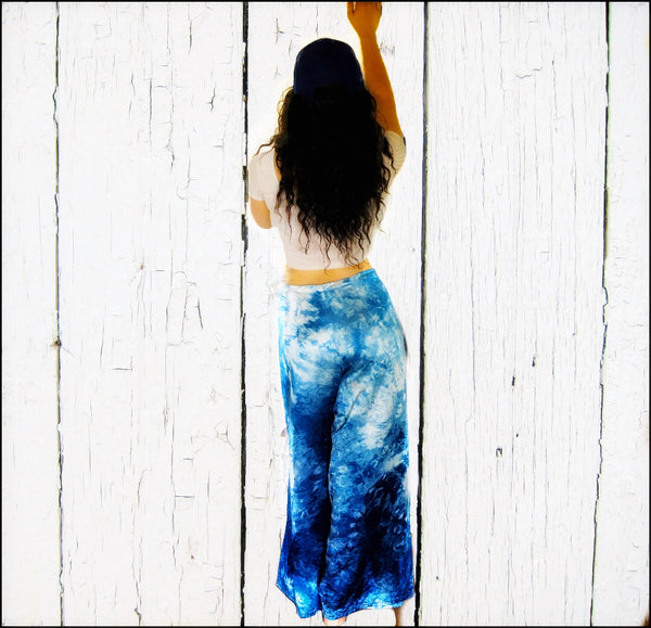 blue dyed hemp wrap pants modelled by girl in white top