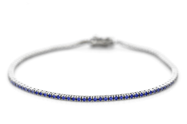 Thin White Gold And Blue Sapphire Tennis Bracelet