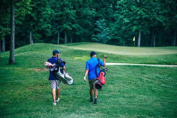 Golfers walking on a mountain golf course