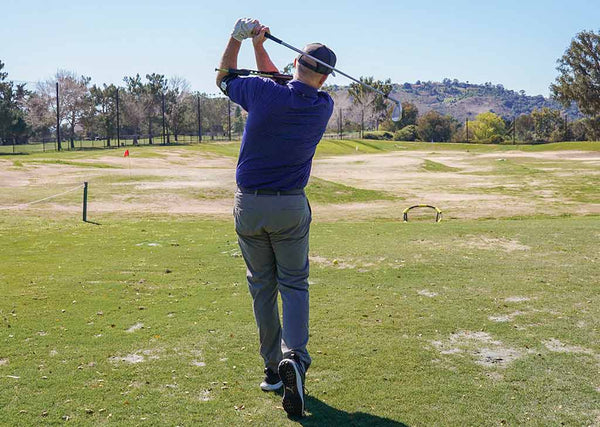 arm release after impact golf swing
