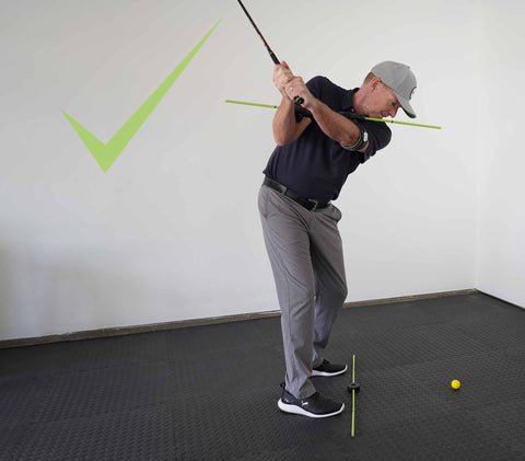 Photo of correct spine angle at the top of your golf swing