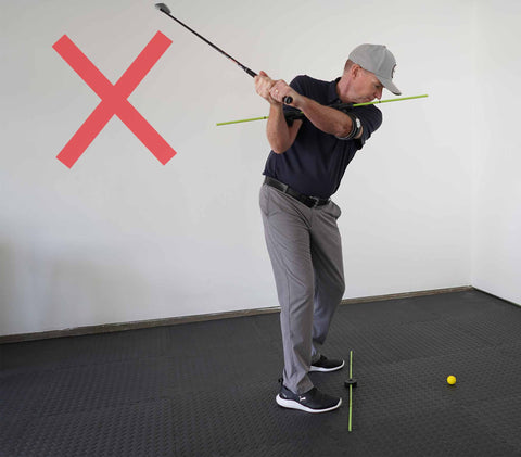Photo of incorrect spine angle at the top of your golf swing