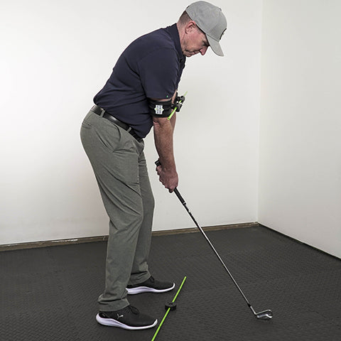 a man setting up for a perfect golf swing