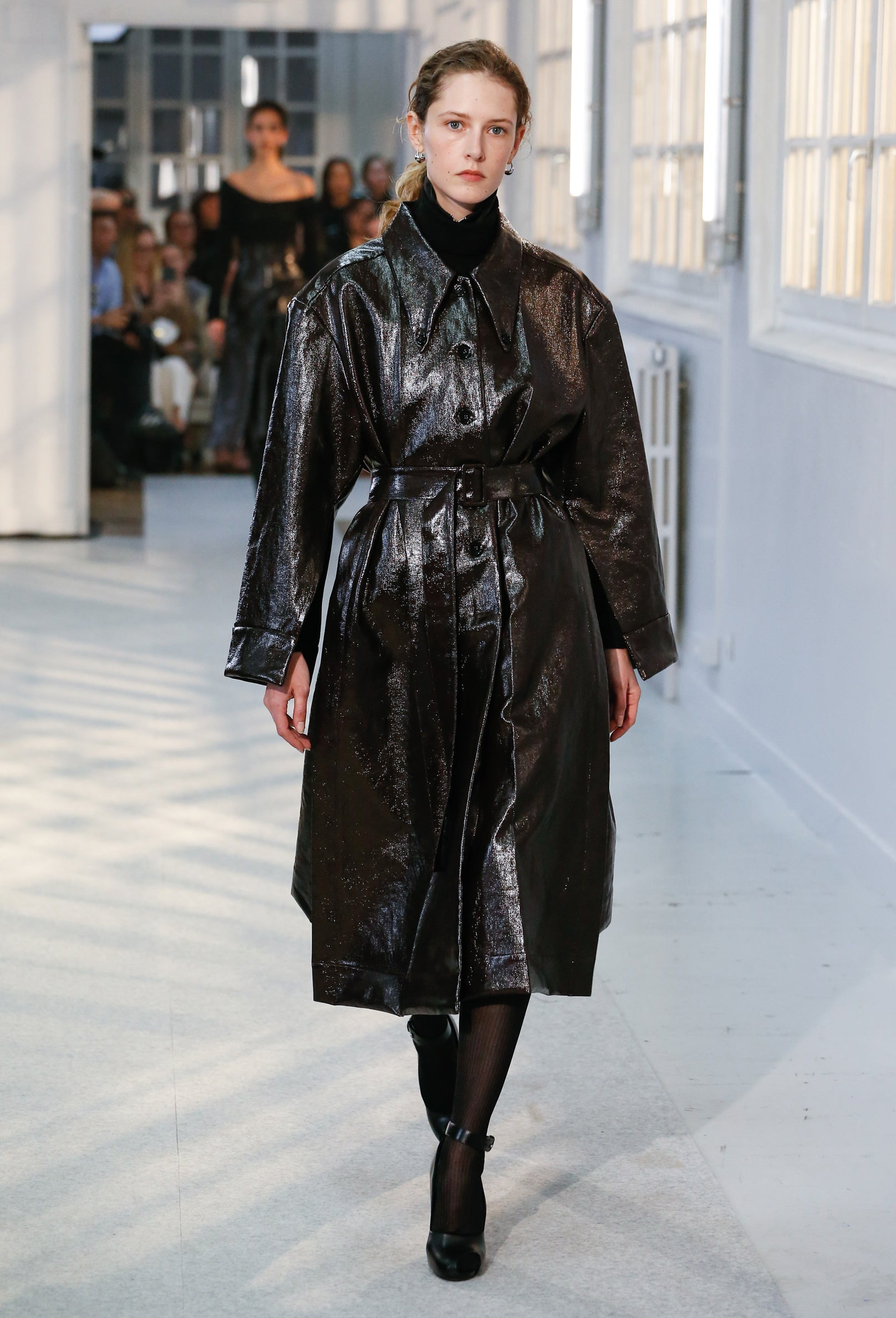 Maria wearing the long shirt coat at the Fall-Winter 2019 show