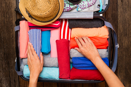 roll your clothing when packing for more space