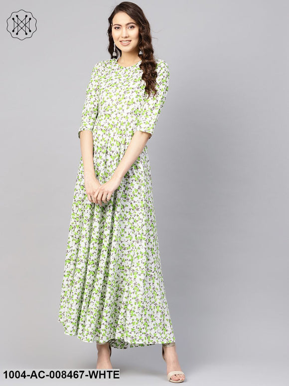 White And Green Floral Printed Round Neck 3/4Th Sleeves Flared Maxi With Deep Back And Tassels Detailing