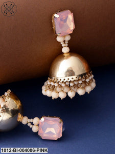 Priyaasi Pink & Gold-Toned Copper-Plated Stone-Studded Handcrafted Dome Shaped Jhumkas