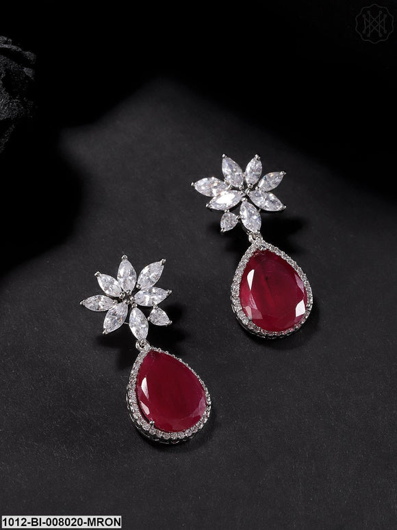 Priyaasi Silver-Toned Cz And Maroon Stone Studded Floral Pattern Drop Earrings