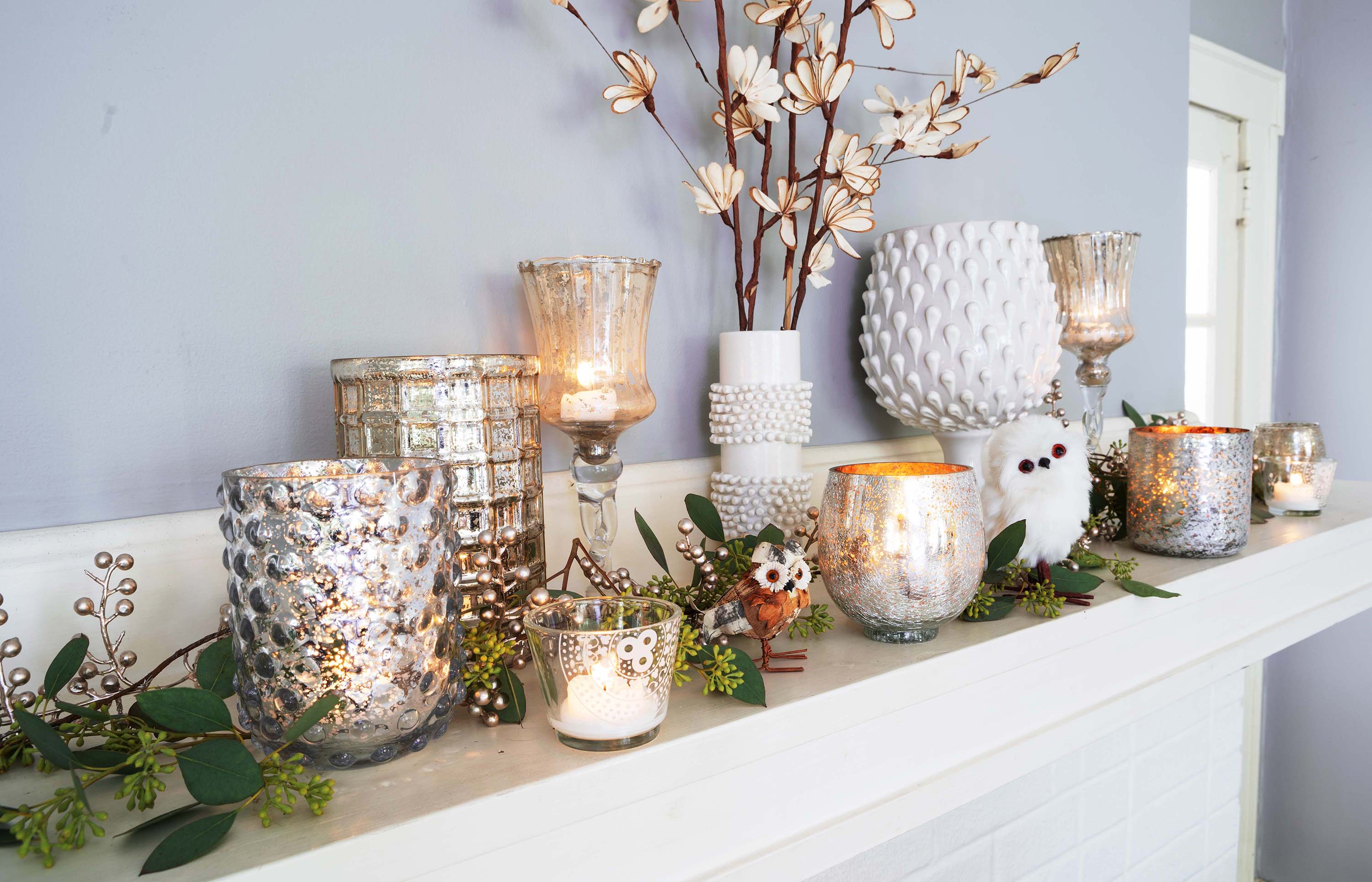 Select candles and glassware to start decorating your mantel.