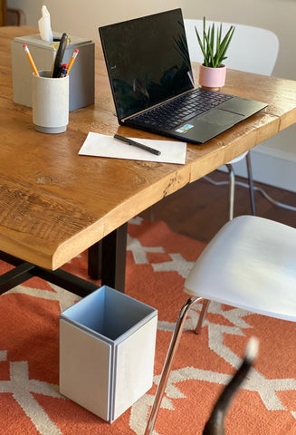 A desk with DKNY Grey Wood accessories